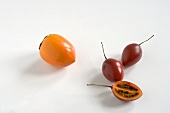 Persimmon and Tamarillo on a White Background