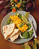 Tandoori Haddock Over Lettuce and Onion; Lime Garnish and Flatbread