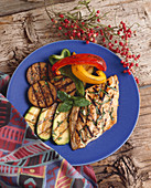 Grilled Bluefish with Grilled Vegetables on a Blue Plate
