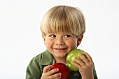 Little Boy Smiling, Holding Two Apples