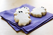 Three Ghost Cookies on Purple Napkins for Halloween