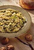 Pesto Rotini in a Bowl with Walnuts
