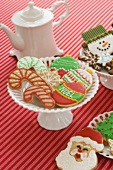 Festive Christmas Cookies and a Tea Pot on a Red Striped Table Cloth