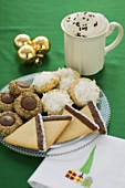 Assorted Cookies for Christmas on a Plate, Mug of Hot Chocolate, Decorations