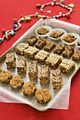 Parchment Paper Lined Pan of Bite-Size Baked Desserts, Christmas Beads