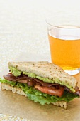 Half a BLT Sandwich with Guacamole, Glass of Beer