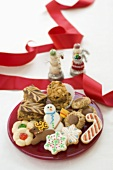 Plate of Assorted Christmas Cookies, Red Ribbon and Snowmen Figures