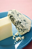 Two Wedges of Cheese on a Blue Plate, Blue Cheese and White Cheddar