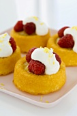 Raspberry Spongecakes with Whipped Cream on a Platter