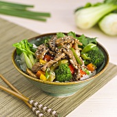 Asian Beef and Vegetables Over Rice in a Bowl, Chopsticks