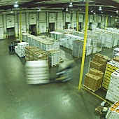 Many Crates of Produce Stacked in a Warehouse