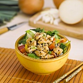 Sesame Chicken and Vegetables Over Rice in a Bowl, Chopsticks