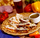 Assorted Quesadillas on a Plate with Salsa Verde on the Side