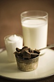 Chocolate Chunks in a Metal Measuring Cup, Glass of Milk and Cream