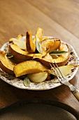 Roasted Pumpkin and Onions on a Small Plate with Fork