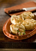 Chicken Dumplings on a Plate, One Split Open