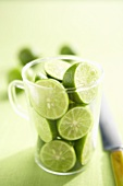 Key Lime Halves in a Glass Pitcher