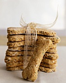 Stack of Homemade Dog Biscuits Tied with a Ribbon; One Loose Biscuit