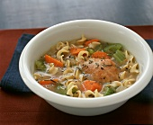 Bowl of Chicken Noodle Soup with Carrots and Celery