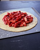 Quartered Strawberries on Rolled Out Pastry Dough