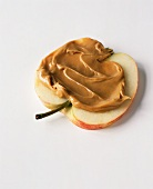 Peanut Butter Spread on an Apple Half; White Background