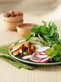 Green salad with radishes, almonds, apples and edamame