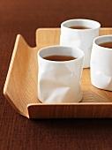 Tea in white beakers