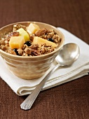 A bowl of crunchy muesli with fresh fruit