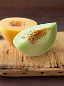 Honeydew melon: half a melon and a wedge of melon