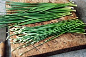 Fresh Garlic Chives on a Board