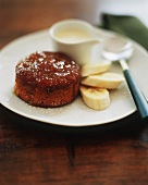 Individual sticky toffee pudding with bananas and vanilla sauce