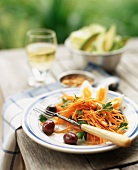 Plate of Carrot Salad on an Outdoor Table