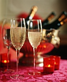 Champagne in Flutes; Bottles in an Ice Bucket; Candles