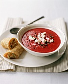 Bowl of Beet Soup with Goat Cheese; Salmon Cucumber Rolls