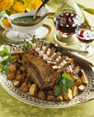 Whole Rack of Lamb on a Platter with Potatoes