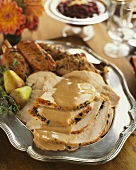 Sliced Roast Turkey with Gravy on a Silver Platter