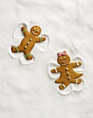 Two Gingerbread Cookies Making Snow Angels (No Exclusivity)