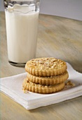 Three Almond Butter Cookies with a Glass of Milk