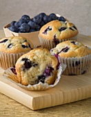 Fresh Baked Blueberry Muffins on a Wooden Board