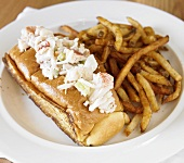 A Toasted Lobster Roll with French Fries