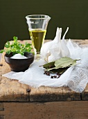 Fresh Spices and Herbs with Cheesecloth and Oil