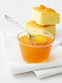 Orange marmalade with two pieces of orange cake