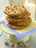 A Stack of Peanut Butter Cookies with Milk and Peanuts