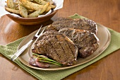 Platter of Grilled Angus Rib Eye Steaks; Oven Fries
