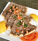 Baked Pita Topped with Ground Lamb and Tomato