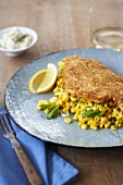 Flounder Fillet with Cornmeal Coating Over Corn