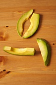 Fresh Avocado Slices on Wood