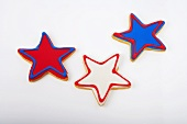 Three Red White and Blue Star Cookies on a White Background