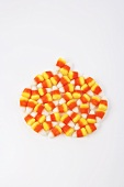 Many Candy Corns on a White Background