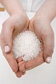 Hands Holding Coarse Sea Salt